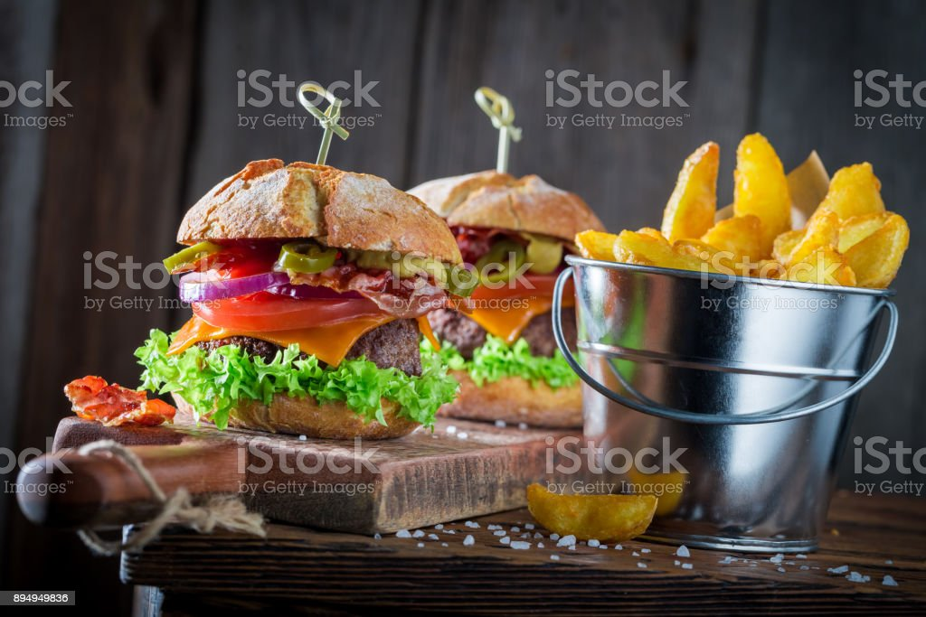 Two tasty hamburger with vegetables, beef and pepperoni stock photo