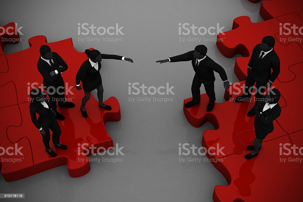 Two teams Merging on a jigsaw puzzle. stock photo