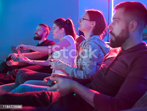 istock Two teams playing video game in entertainment center 1184225586