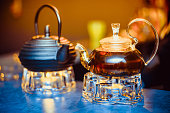 two teapots with brewed tea are on the table