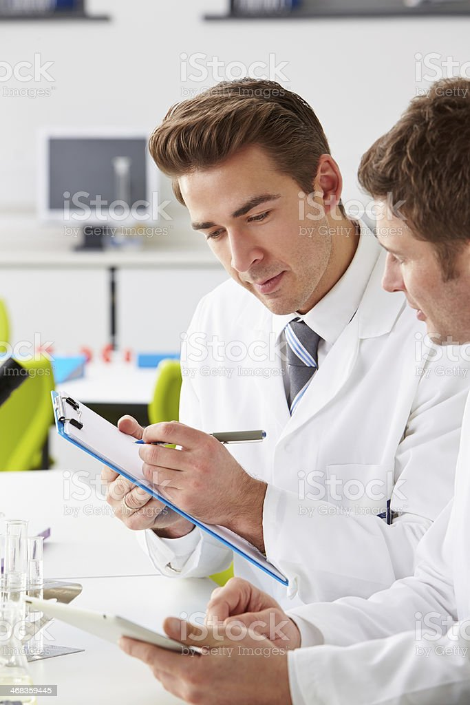 Two Technicians Working In Laboratory royalty-free stock photo
