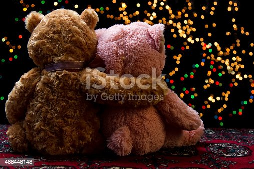 Teddie bear with white with red rose sitting with bokeh background