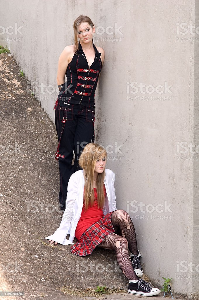 Two Teen Models By Contrete Wall Stock Photo - Download