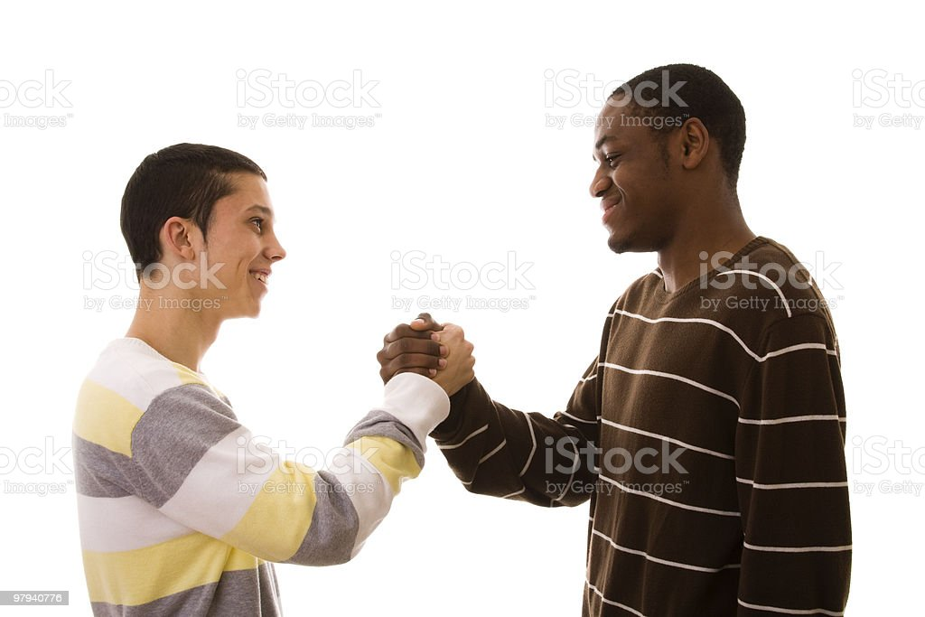 Two teenage friends shaking hands royalty-free stock photo