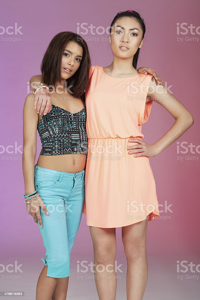 Two teenage friends standing together in studio royalty-free stock photo