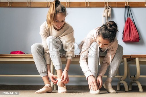 istock two teenage girls dressing for ballet lesson 890744186