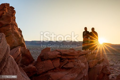 istock Two Teenage Native American Indian Navajo Sister in Traditional Clothing Enjoying the Vast Desert and Red Rock Landscape in the Famous Navajo Tribal Park in Monument Valley Arizona at Dawn 1173222660