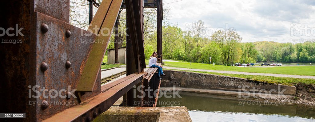 Two teenager girls exploring old industrial zone. Williamsport, Maryland, USA stock photo