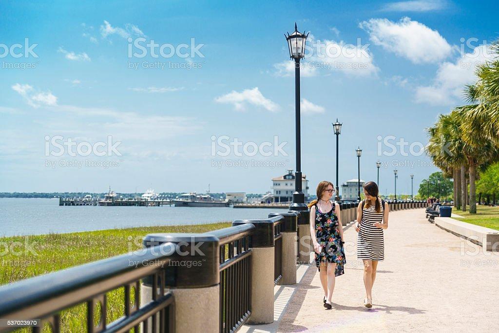 Two teenager girls walks in Waterfront Park, Charleston, South Carolina stock photo