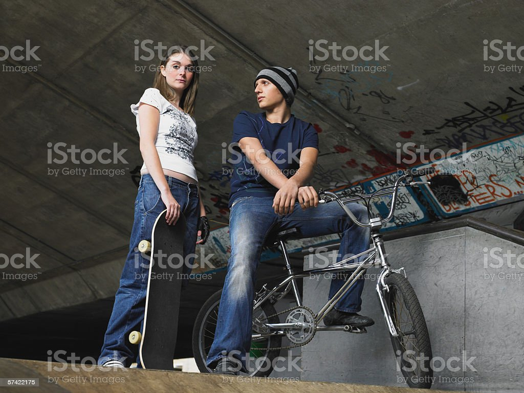 Two teenagers at skate ramp stock photo