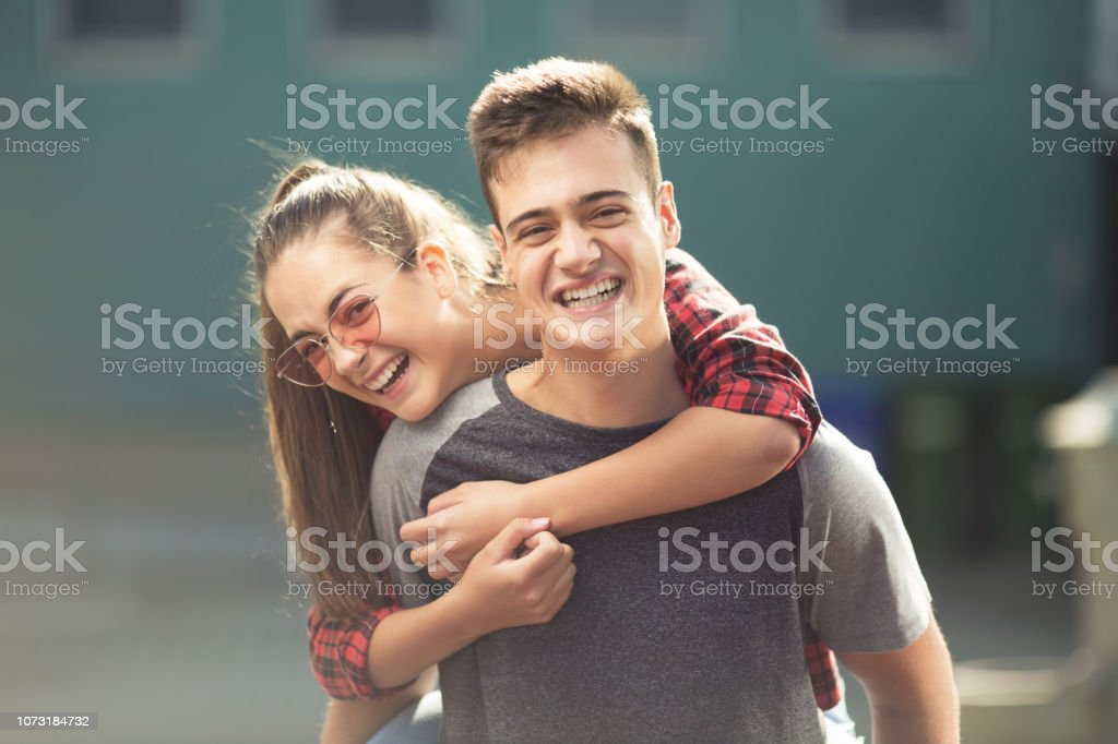 Two teenagers laughing stock photo