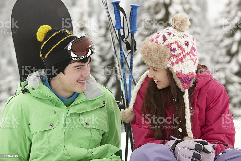 Two Teenagers On Ski Holiday In Mountains royalty-free stock photo