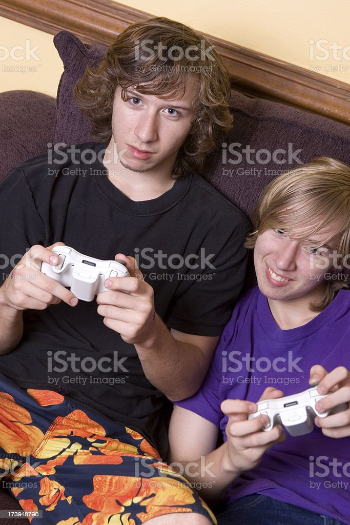 Two Teenagers playing video games royalty-free stock photo