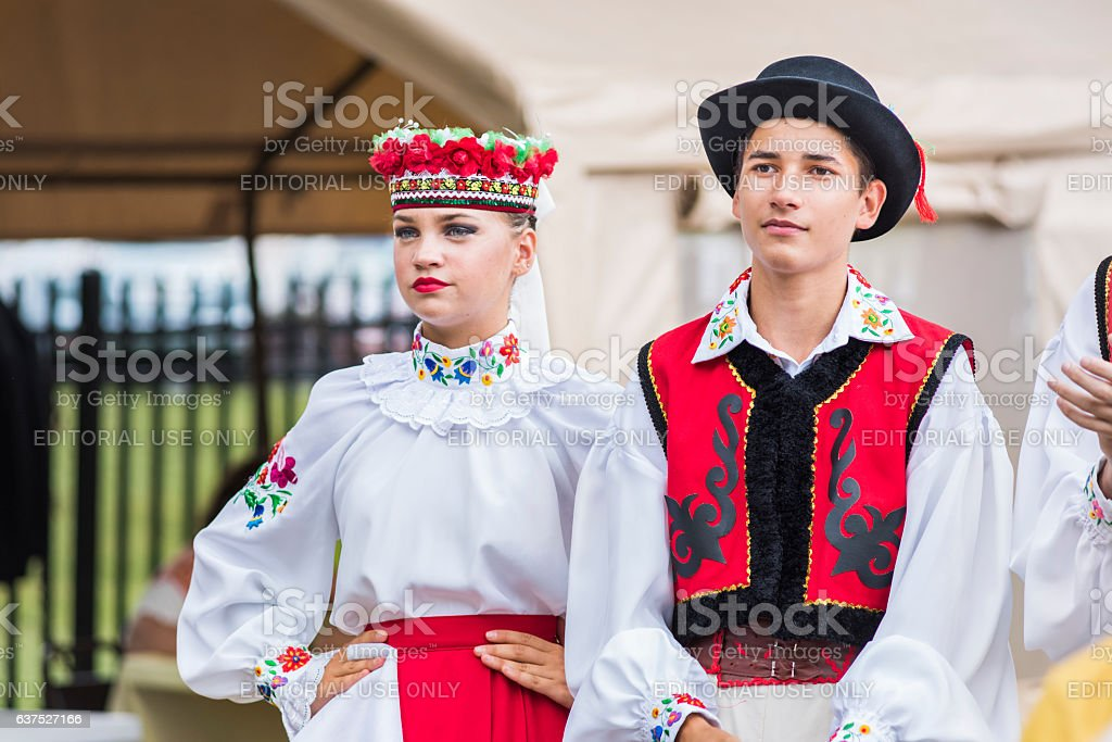 Two teens dressed in traditional red Ukrainian embroidered costume clothes stock photo