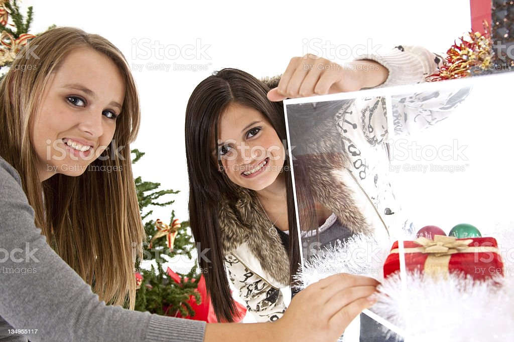 Two teens looking in a display case. royalty-free stock photo