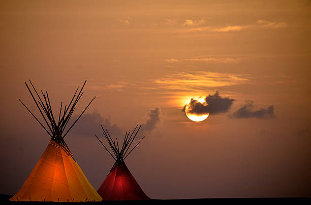 Two Teepees at Sunset stock photo