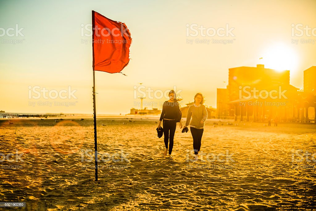 Two tennager girls walking at the Coney Island beach, Brooklyn stock photo