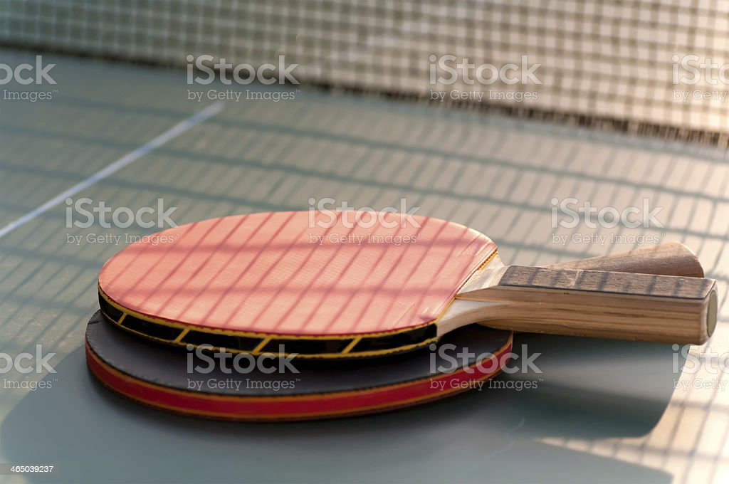 two tennis racket on the table near  grid royalty-free stock photo