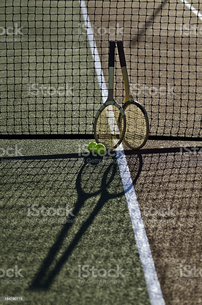 Two tennis racquets/rackets on court, with shadows royalty-free stock photo