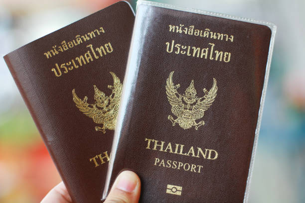 Two Thai passports in hand, travel concept Two Thai passports in hand, travel concept pasport malaysia stock pictures, royalty-free photos & images