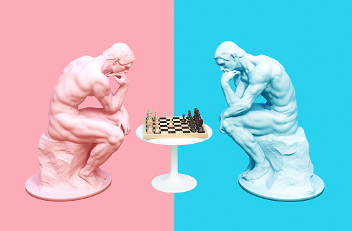 istock Two Thinkers Pondering The Chess Game On Pink And Blue Backgrounds 1155739236