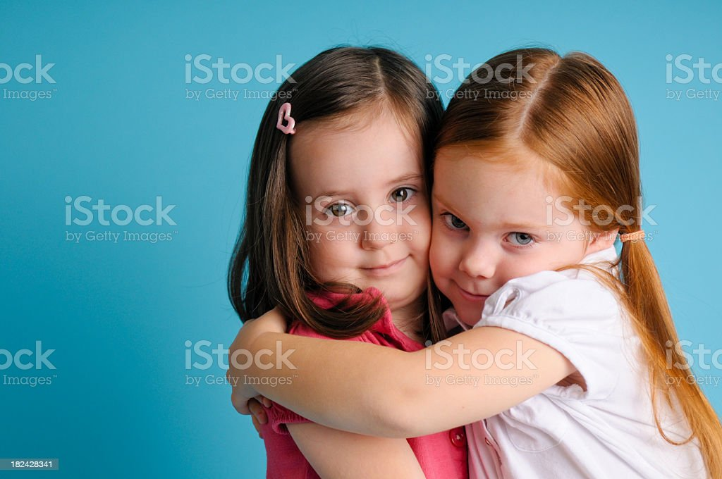 Two Three-Year-Old Friends Giving Each Other a Hug royalty-free stock photo