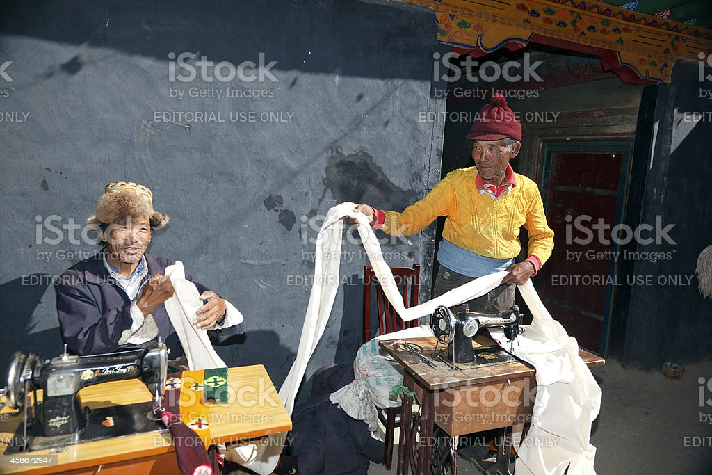 Two Tibetan Tailors with sewing machines stock photo