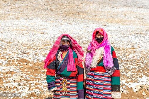 istock Two Tibetan women standing in the wilderness 1213400135