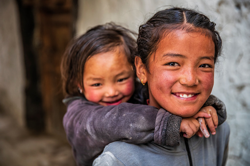 Two Tibetan young girls from Lo Manthang, Upper Mustang. Mustang region is the former Kingdom of Lo and now part of Nepal,  in the north-central part of that country, bordering the People's Republic of China on the Tibetan plateau between the Nepalese provinces of Dolpo and Manang.