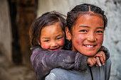 istock Two Tibetan young girls, Upper Mustang, Nepal 1220490176