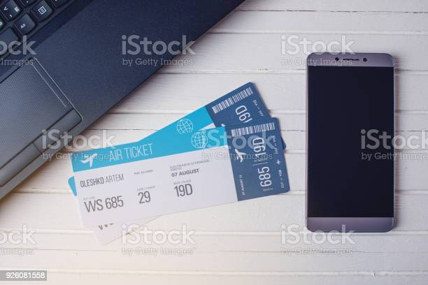 Two tickets are on the table with a phone and laptop concept of the picture id926081558?b=1&k=6&m=926081558&s=612x612&h=fty7gf6wavniehepfizgyxkilkxm9broghytihntajy=