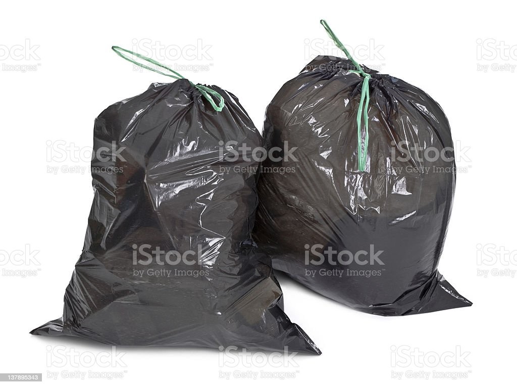 two tied garbage bags on white stock photo