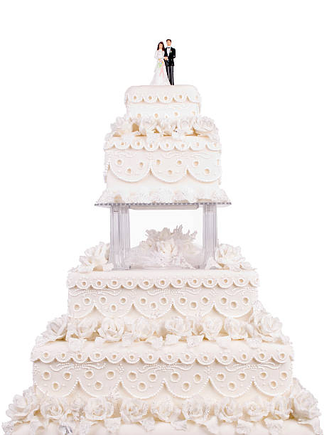 two tier wedding cake with plastic couple on top - big cake stock photos and pictures