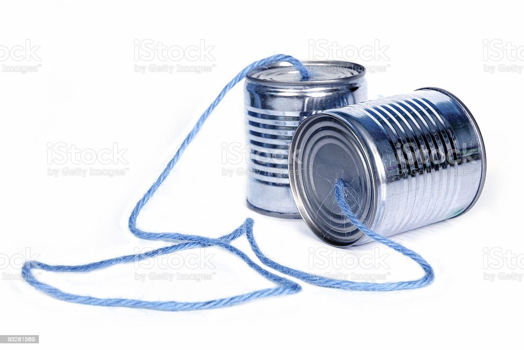 Two tin cans connected with string forming telephone stock photo