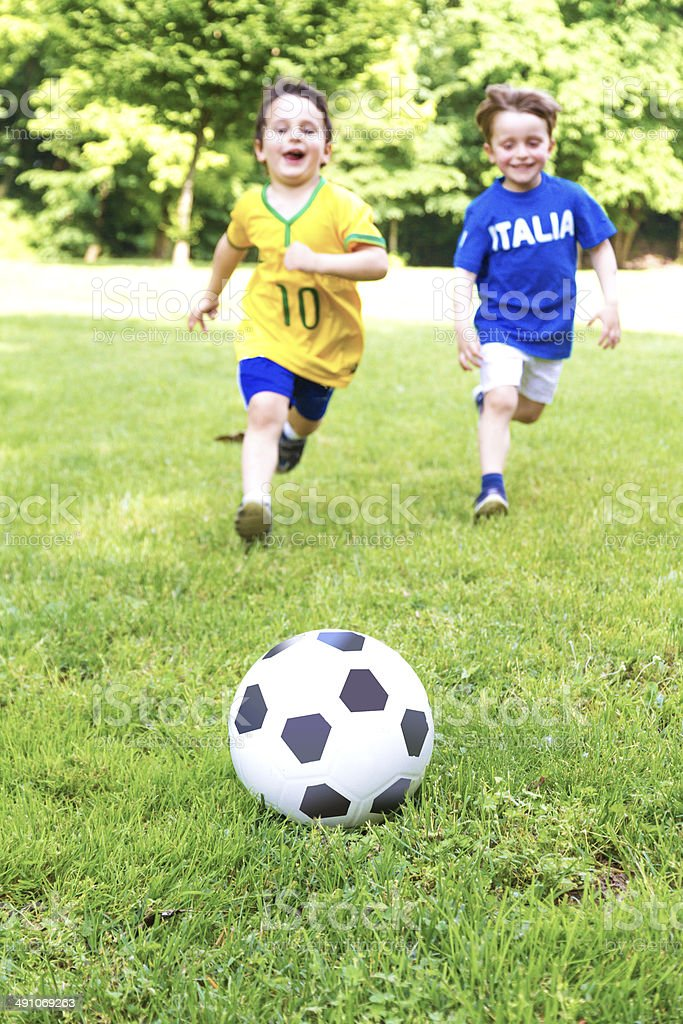 Two toddlers playing soccer royalty-free stock photo