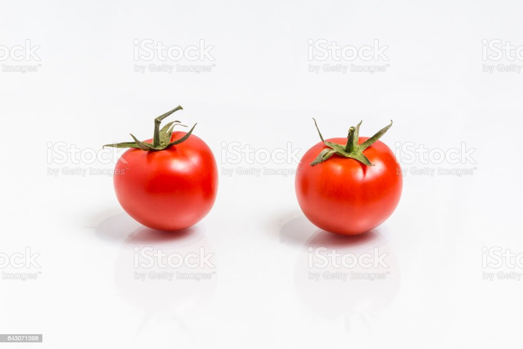 Two tomatoes, isolated on white background stock photo