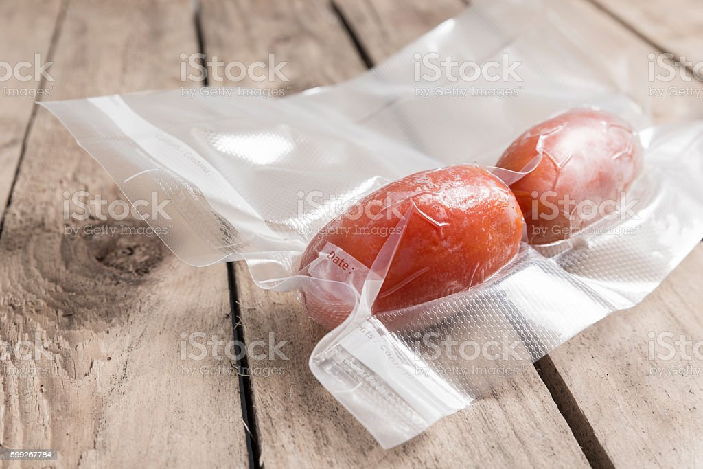 two tomatoes San Marzano vacuum stock photo