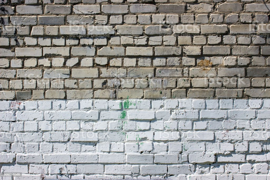 Two Tone Brick Wall For Design With Spots Of Paint Stock