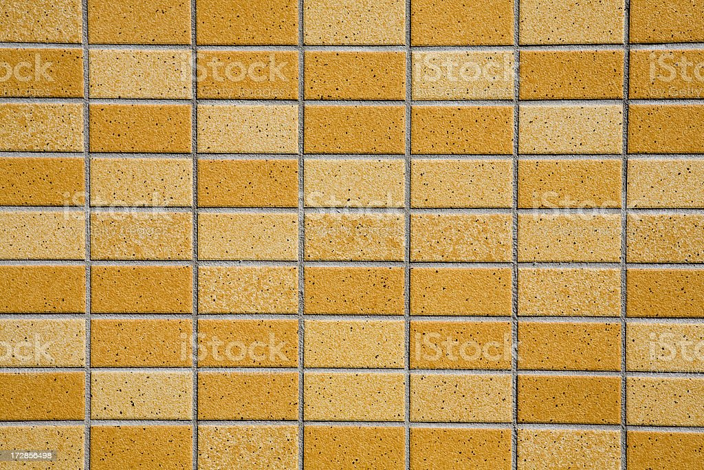 Two toned sandy brown and tan tile brick wall royalty-free stock photo