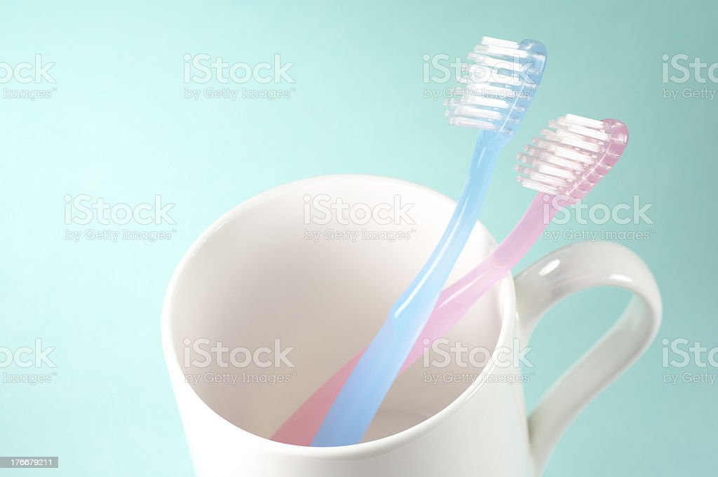 Two toothbrushes and a cup. royalty-free stock photo