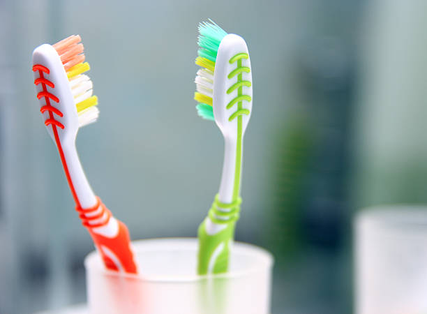 Two toothbrushes in the glass. stock photo