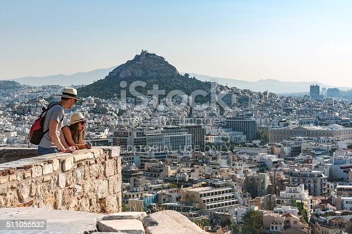 621898406istockphoto Two tourists look at panorama of Athens 511055532