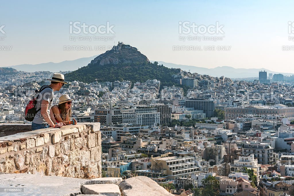 Two tourists look at panorama of Athens stock photo