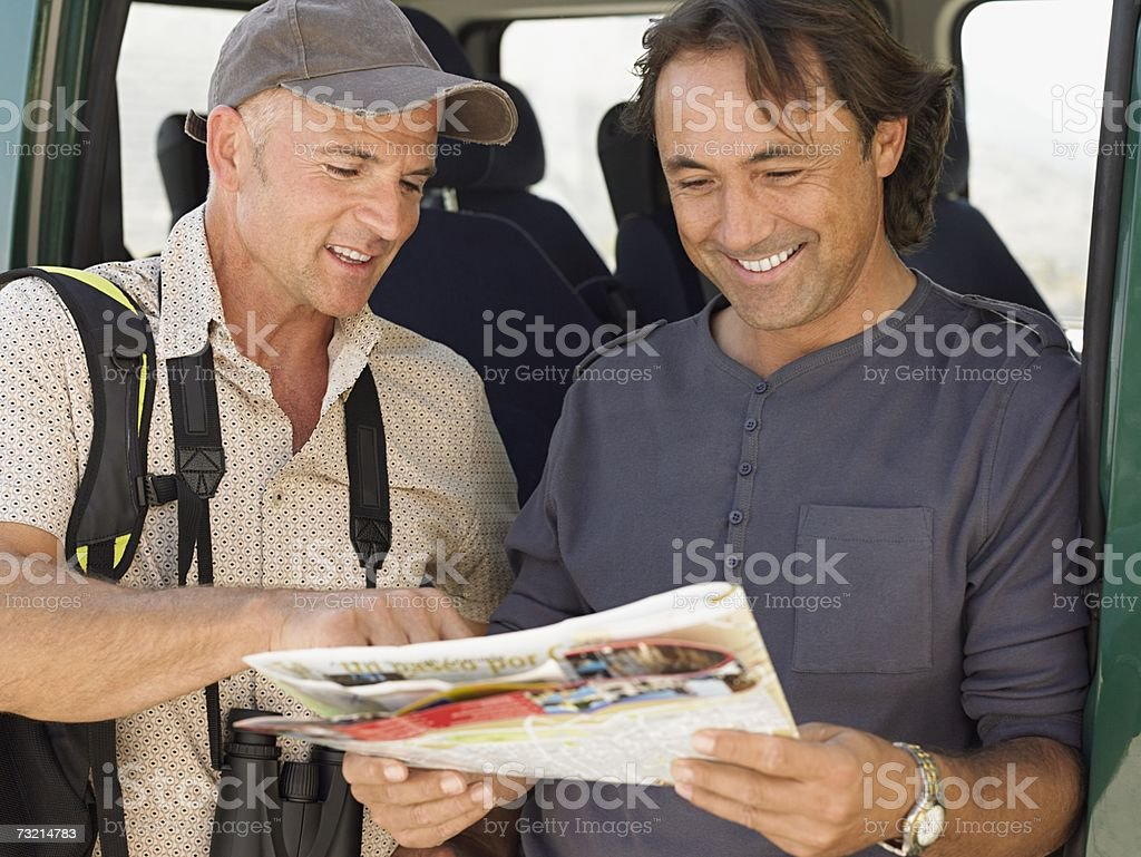 Two tourists looking at a map royalty-free stock photo