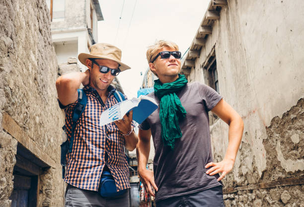 Two tourists try to navigate with guidebook on unknown asian street stock photo