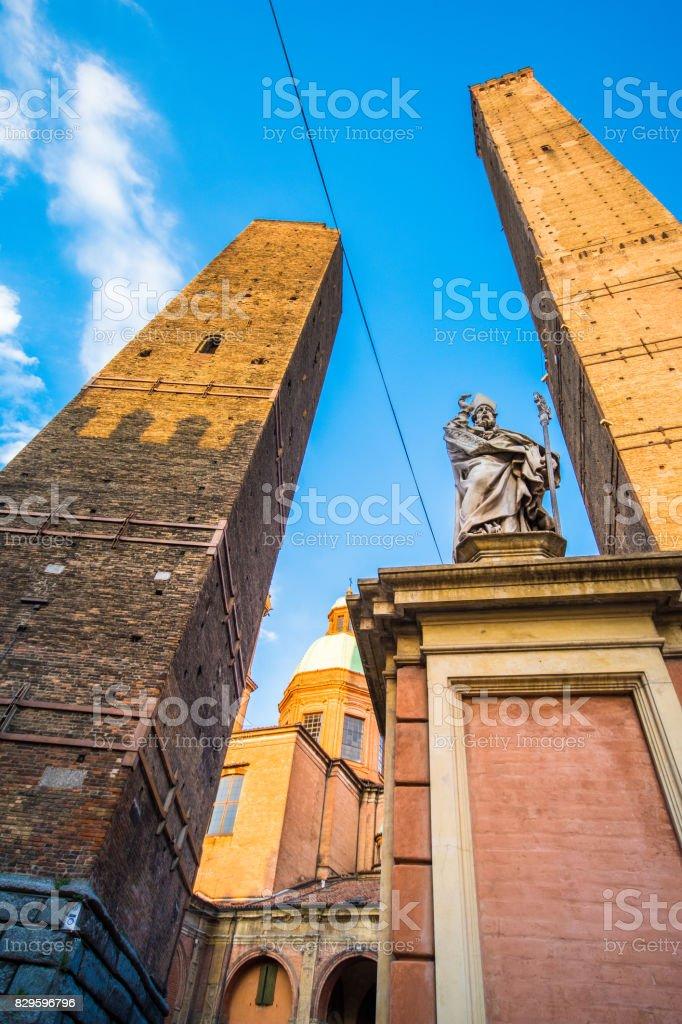 Two Towers (Due Torri), Asinelli and Garisenda, symbols of medieval Bologna towers and Chiesa di San Bartolomeo. Bologna, Emilia-Romagna, Italy stock photo