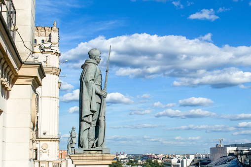 Monuments on the top of two towers on Railway station square City Gates Minsk Belarus