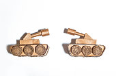 two toy tanks made by children from corrugated cardboard. toy cardboard tanks isolated on a white background.