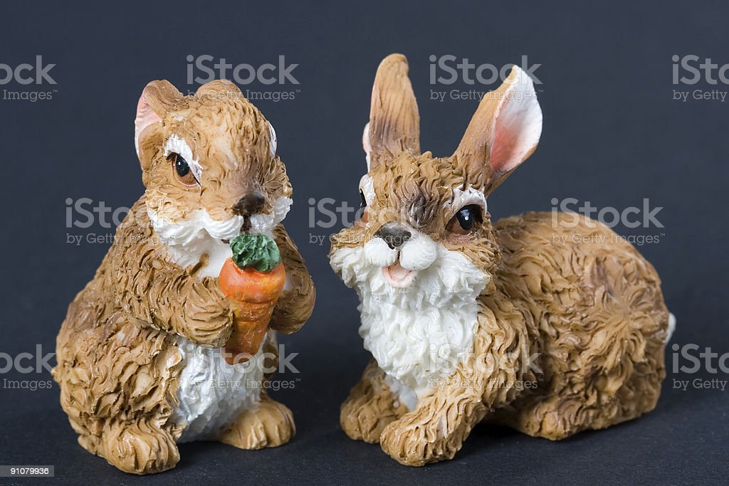 Two toy-rabbits stock photo