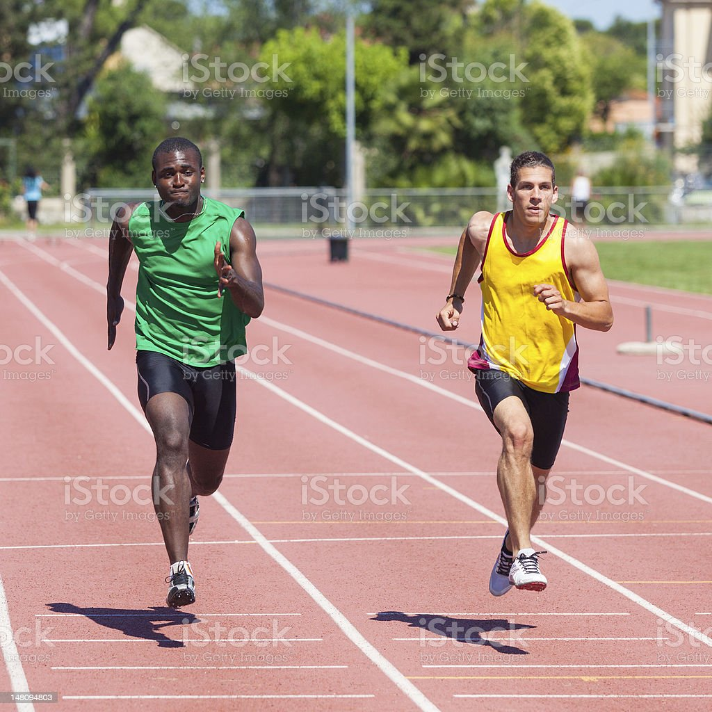 Two Track and Field Athletes Running royalty-free stock photo